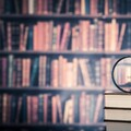 Books and magnifying glass-23924