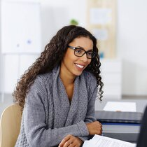 Attractive young African American businesswoman wearing glasses