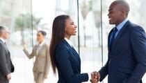 african-american-professionals-shaking-hands-shutterstock_158383982-78774.jpg