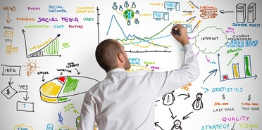 man-writing-on-white-board-shutterstock_124904123-78774.jpg