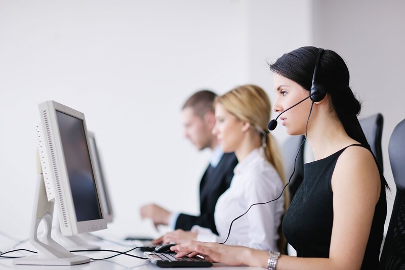 business people group with headphones giving support in help desk