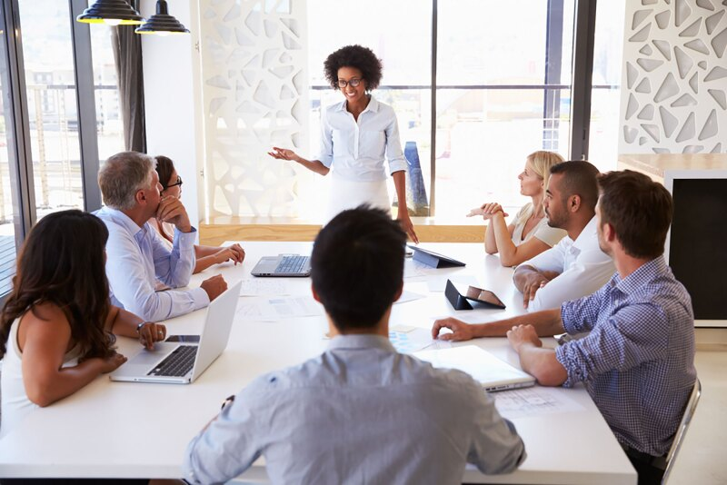 business woman leading talk in conference