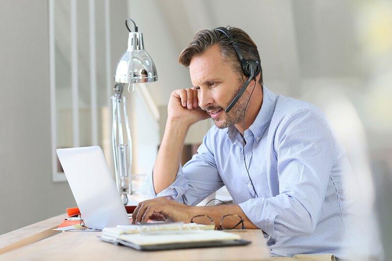 Businessman teleworking, headset on