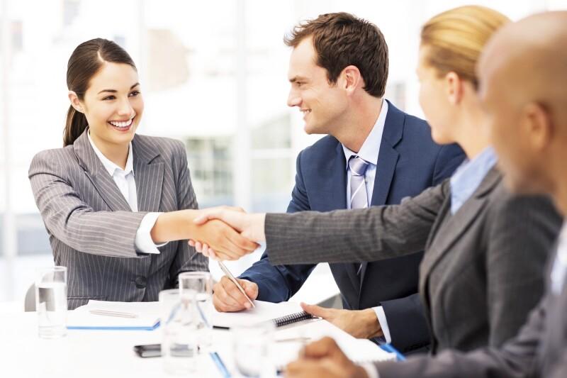 Happy Businesswomen Shaking Hands During Meeting