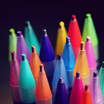 colorful pencils on black background.jpg