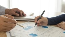 manager analyze financial numbers