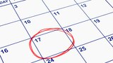 A date circled in red on a calendar