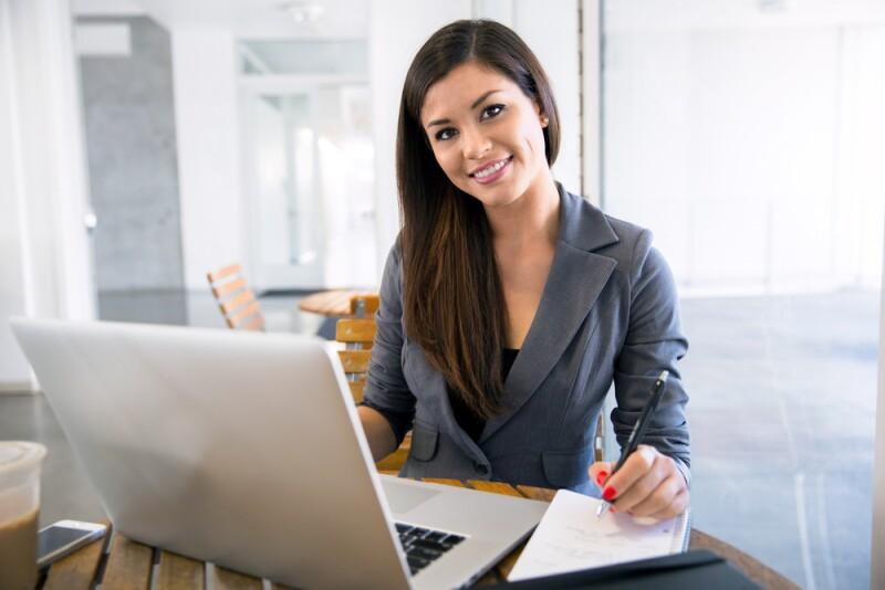 woman-smiling-on-laptop-shutterstock_293098250-78774.jpg