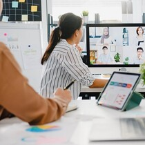 Asia businesspeople using desktop talk to colleagues discussing business brainstorm about plan in video call meeting in new normal office. Lifestyle social distancing and work after corona virus..jpg