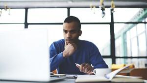 afro american male international student watching training webinar