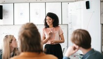 Young business woman giving presentation to coworkers