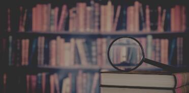 MEM-Books and magnifying glass-23924