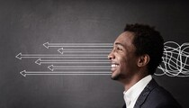 Concept of decision making African American guy with arrows and wires