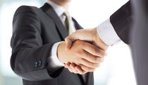 businessman shaking hands each others hand