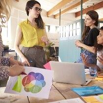Female Designers Having Brainstorming Meeting In Office