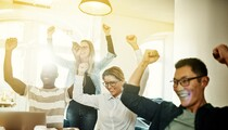 Ecstatic group of diverse coworkers cheering together in an office-AdobeStock-193769735