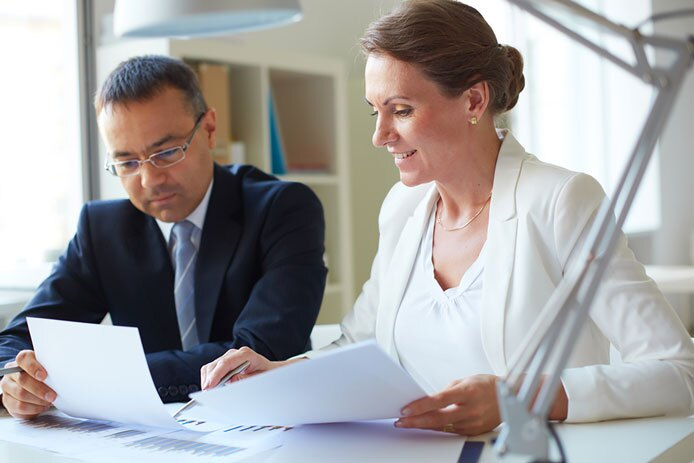 Two business people sharing information