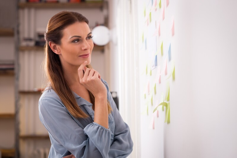 Woman looking business plan