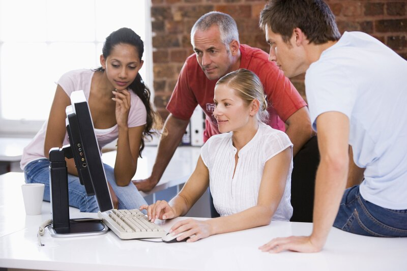 Group of business people working around computer