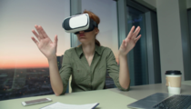 young-girl-wears-and-uses-virtual-reality-technology-vr-glasses-to-work-in-modern-office-in-a-skyscraper-the-creation-of-the-presentation.png